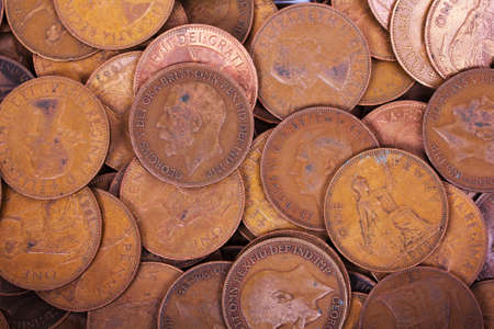 penny: Old penny coins spread out for a background Stock Photo