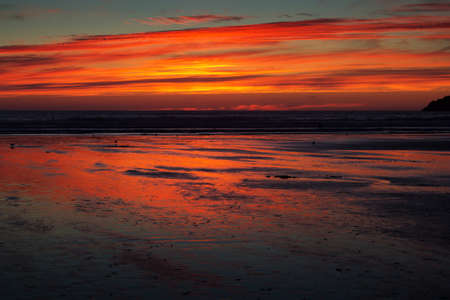 Colourful sunset over the beach at Polzeath, Cornwall Stock Photo