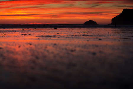 wispy: Colourful sunset over the beach at Polzeath, Cornwall Stock Photo
