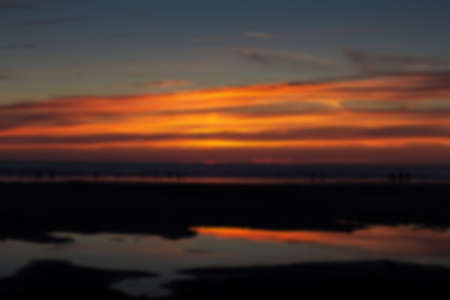 wispy: Colourful sunset over the beach at Polzeath, Cornwall Out of focus.