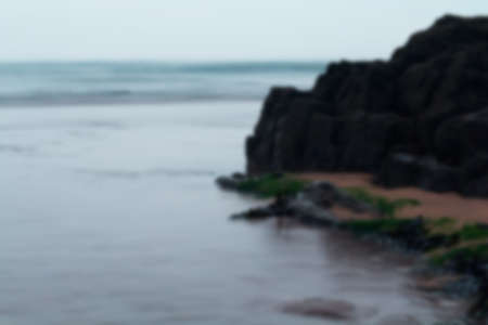 adentro y afuera: Long exposure shot of the sea coming in Out of focus.