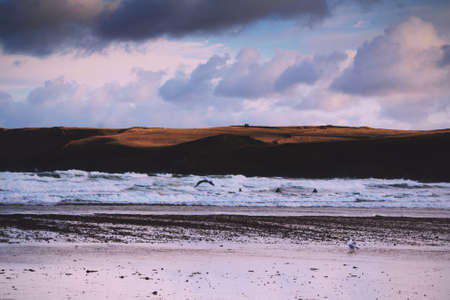 wispy: Beautiful view over the sea from Polzeath, Cornwall. Vintage Retro Filter. Stock Photo
