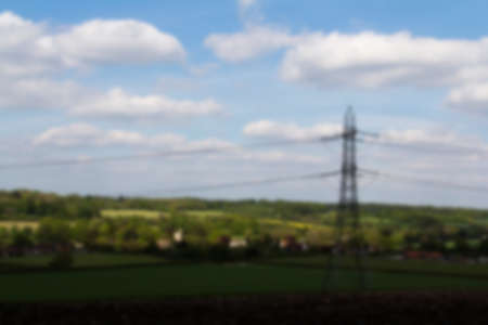 torres de alta tension: Electricity pylons going through the English countryside Out of focus.