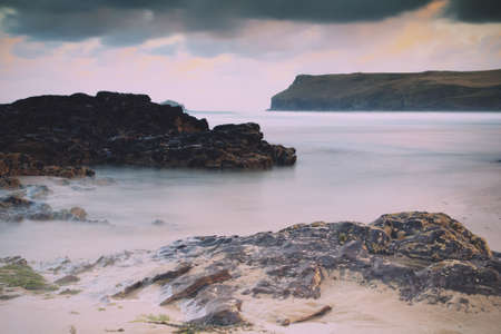 wispy: Early morning view over the beach at Polzeath, Cornwall Vintage Retro Filter.