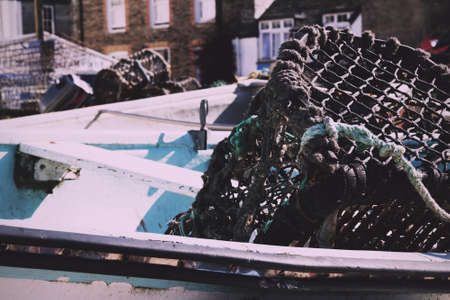traps: Lobster traps in the harbour, Port Issac, Cornwall Vintage Retro Filter. Stock Photo