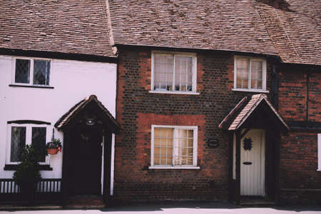 typically british: BEACONSFIELD, ENGLAND - JUNE 2016: Old terrace houses in the old town Vintage Retro Filter. Editorial