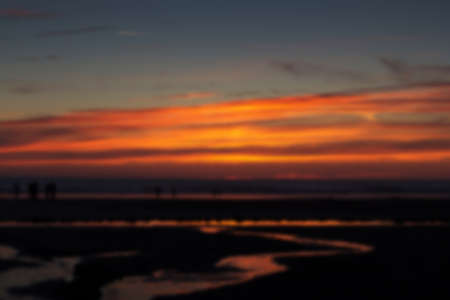 Colourful sunset over the beach at Polzeath, Cornwall Out of focus.