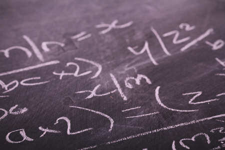 sums: Close up of blackboard with maths equations and sums Vintage Retro Filter.
