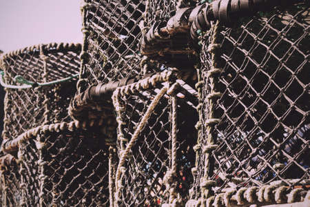 crab pots: Lobster traps in the harbour, Port Issac, Cornwall Vintage Retro Filter. Stock Photo
