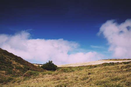 View of countryside from costal path near Polzeath, Cornwall Vintage Retro Filter. Stock Photo