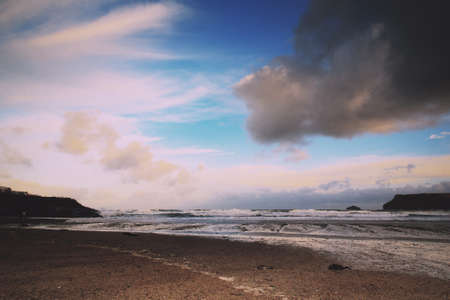 wispy: Beautiful view over the sea from Polzeath, Cornwall Vintage Retro Filter.