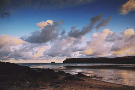wispy: Early morning view of the beach at Polzeath, England Vintage Retro Filter.