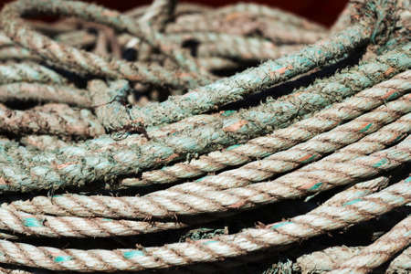 Close up of old fishing ropes coiled up Stock Photo