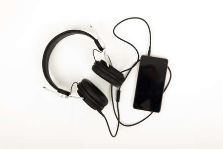 Pair of headphones against a light coloured background