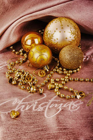 Festive gold Christmas decorations on a fabric background HDR Filter.