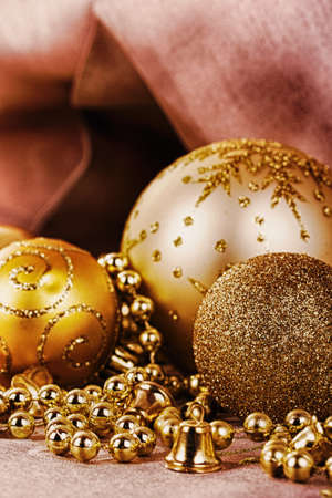 festive gold christmas decorations on a fabric background hdr filter stock photo 64782468
