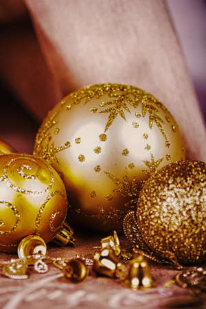 hdr background: Festive gold Christmas decorations on a fabric background HDR Filter.