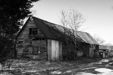 Old derelict empty wooden barn in the country