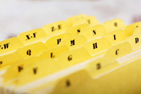 Close up of alphabetical index cards in a box Фото со стока - 72560853