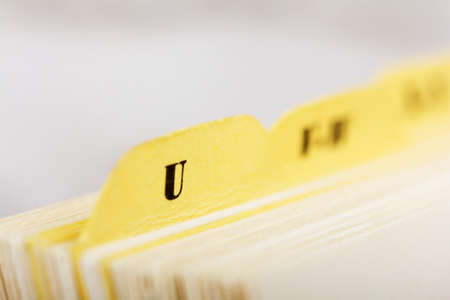 listings: Close up of alphabetical index cards in a box
