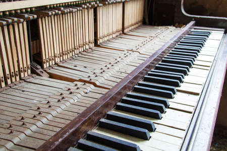 corroded: Keys from an old broken and damaged piano Stock Photo