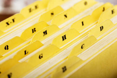 Close up of alphabetical index cards in a box Фото со стока - 76669729