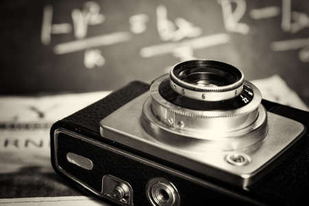 Old vintage retro camera with mocked up daily newspaper