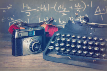 Old vintage retro camera with an old-fashioned typewriter
