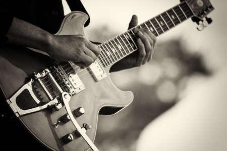 Close up of man playing a rock guitar Standard-Bild