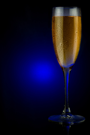 Cold champagne glass on a blue.