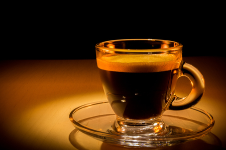 Coffee cup esspresso in a warm lighting. 스톡 콘텐츠