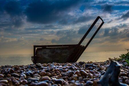 Vintage sea scoop on the shingle shore.