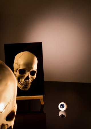 Human scull in the mirror yearning for completion.