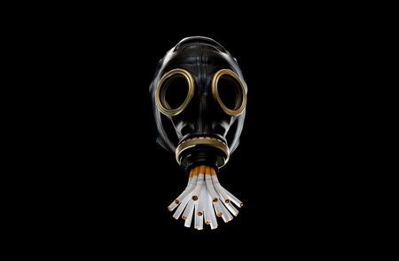 Gas mask smoking bunch of cigarettes, anti smoking campaign. 스톡 콘텐츠