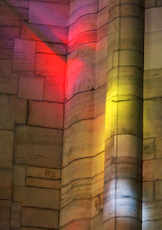 Impressive light reflections on wall through stained glass in the cathedral of Milan, only visible for some minutes on a sunny day