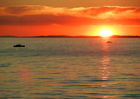 Summer Sunset with 2 pedalos on Lake Constance Stock Photo