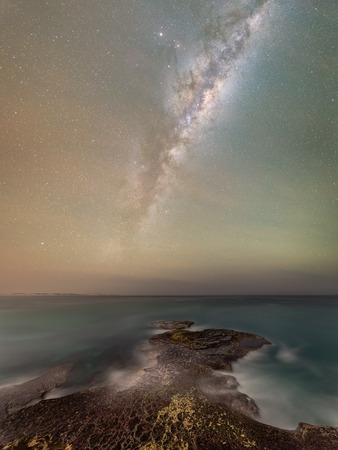 stepping stone: The milky way core rising over the ocean with spectacular rock formations leading the way in Arniston - South Africa