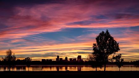 denver at sunrise: Downtown Denver skyline at sunrise with lake reflection Stock Photo