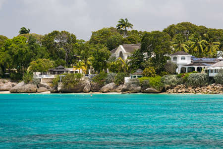 residences: Residences as seen from a catamaran off the coastline of Barbados Stock Photo