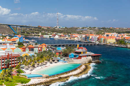 The Queen Emma Bridge is a pontoon bridge across St. Anna Bay in Curacao