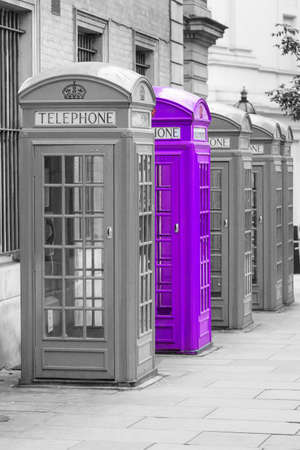 telephone: Five Red London Telephone boxes all in a row in the City Stock Photo