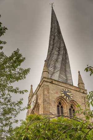 Chesterfield Church (Saint Mary and All Saints) is in the town of Chesterfield in Derbyshire, England. It is most known for its twisted spire, an architectural phenomenon, The Crooked Spire. Stock Photo
