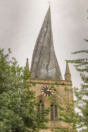 chesterfield: Chesterfield Church (Saint Mary and All Saints) is in the town of Chesterfield in Derbyshire, England. It is most known for its twisted spire, an architectural phenomenon, The Crooked Spire. Stock Photo