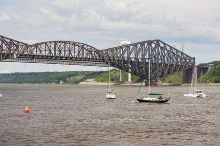 The Quebec Bridge is a riveted steel truss structure and is still the longest cantilever bridge span in the world.