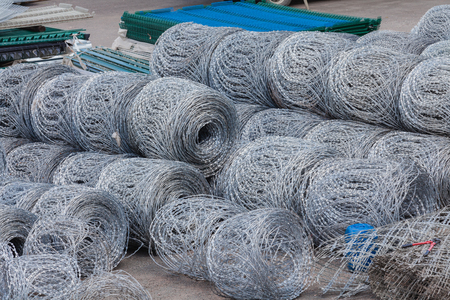 fencing wire: Razor wires rolls stacked yard fencing security