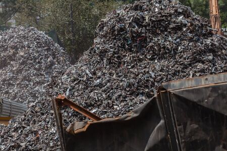resale: Scrap metal recycling yard with piles of shredded metals