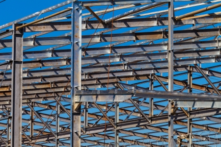 warehouse building: Building warehouse steel metal frame structure in morning blue sky