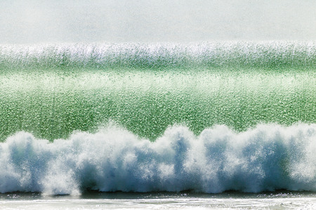 hollow wall: Crashing breaking hollow ocean wave at impact with water texture bubble details in wall of sea water  Stock Photo