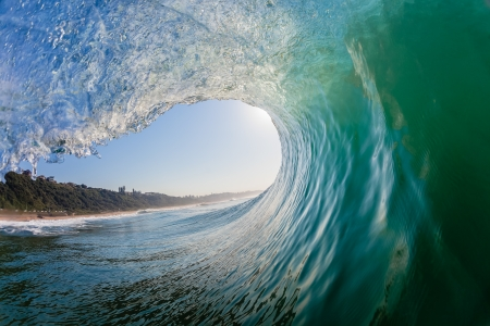 Swimming surfing view of hollow crashing ocean wave inside vortex looking out