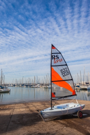 slipway: Sailing junior single sailor yachts on harbor slipway waiting for morning winds for junior sailors  Editorial